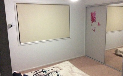 Bedroom with built ins in Rothwell