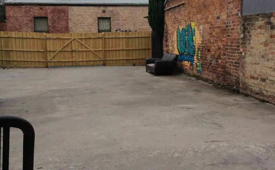 Fenced yard for car parking or storage
