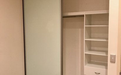 Queen Sized Bedroom Storage Space with builtin