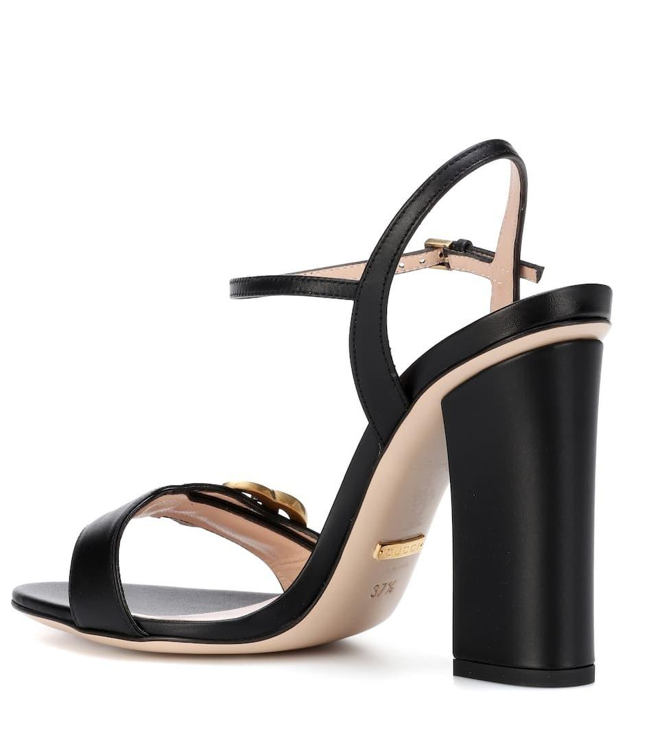 f95e25f6e65 ... Gucci Marmont Embellished suede sandals in black ...